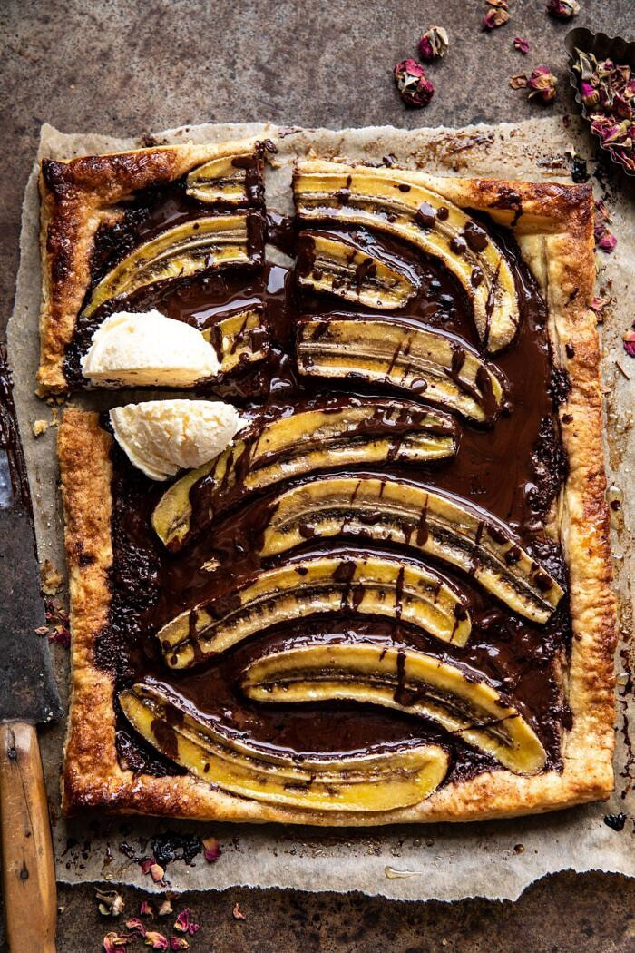 overhead photo of Warm Chocolate Banana Galette with square cut out and ice cream on top