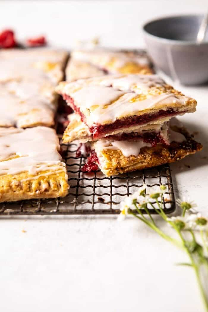 side angle of Giant Strawberries n' Cream Pop Tart cut into pieces and stacked