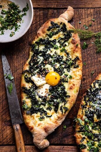 Khachapuri (Georgian Cheese Bread) with Kale and Herb Sauce | halfbakedharvest.com #pizza #easyrecipes #cheese #bread