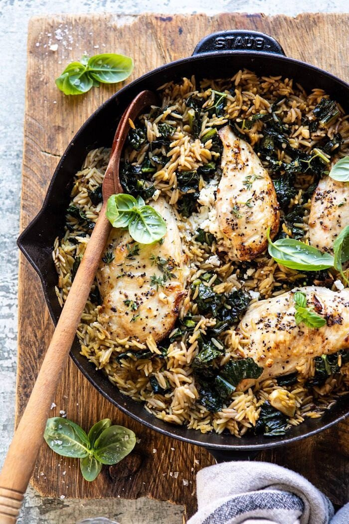 overhead photo of One Skillet Goat Cheese Stuffed Chicken and Orzo with spoon in skillet