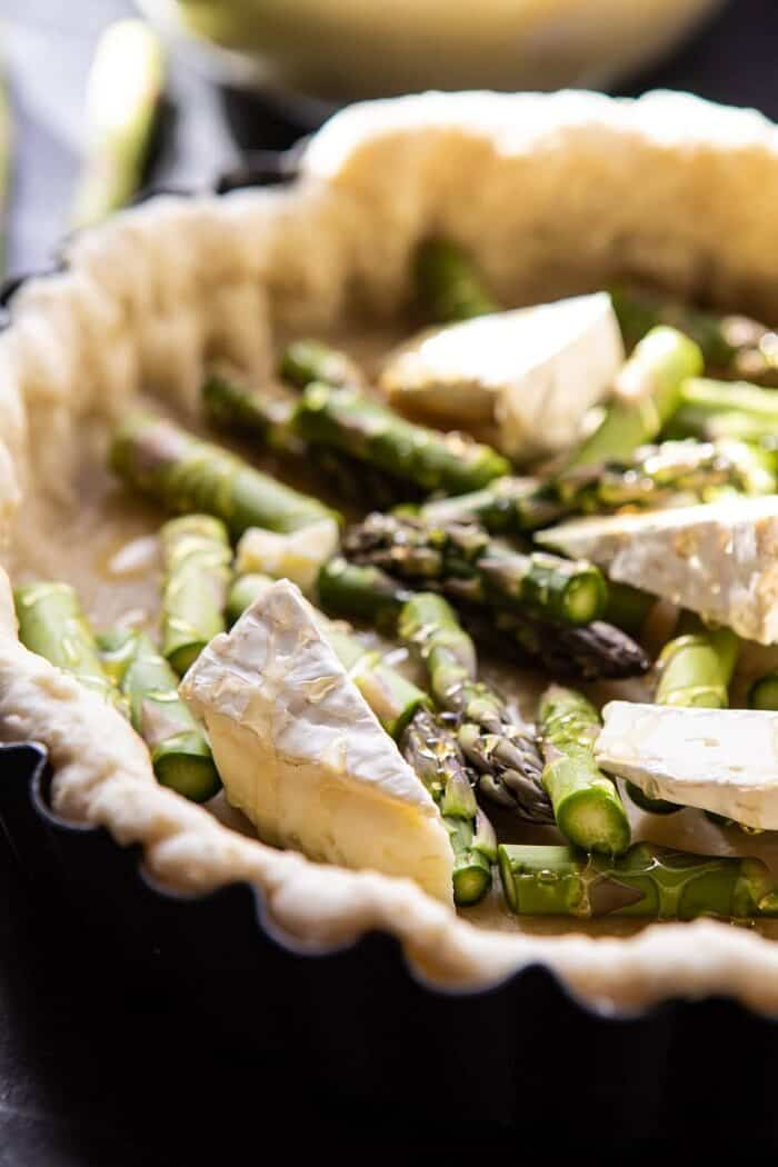 side angle photo of Asparagus and Brie before baking