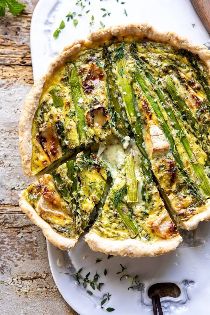 overhead photo of Asparagus and Brie Quiche with 2 slices cut