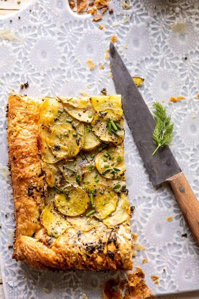 overhead photo of Cheesy Potato Chive Galette slice