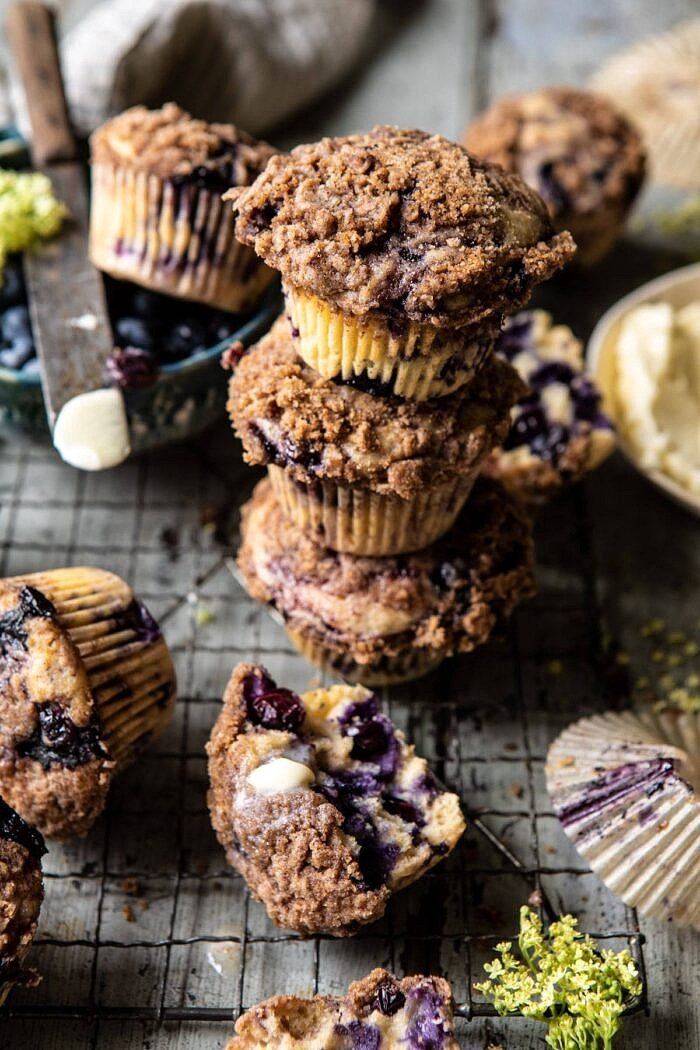 Blueberry Swirl Coffee Cake Muffins stacked on top of each other