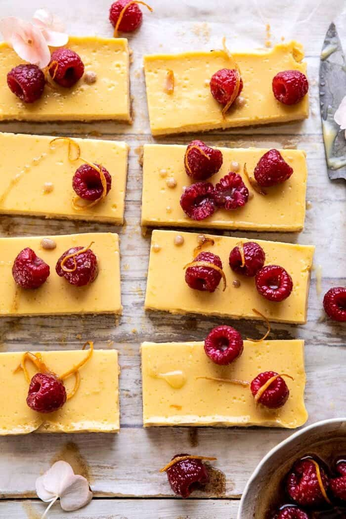 close up overhead photo of Creamy Lemon Bars with Browned Butter Raspberries