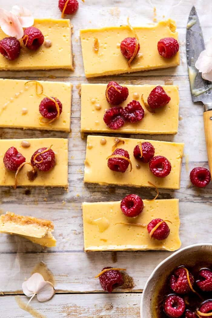 close up photo of Creamy Lemon Bars with Browned Butter Raspberries