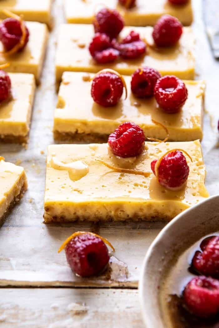side angle photo of Creamy Lemon Bars with Browned Butter Raspberries