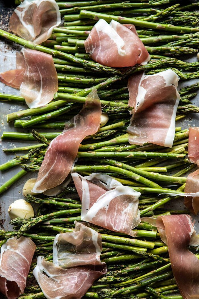 Prosciutto and Asparagus on baking sheet before roasting