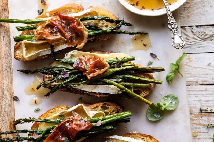 horizontal photo of Crispy Prosciutto, Asparagus, and Brie Toast