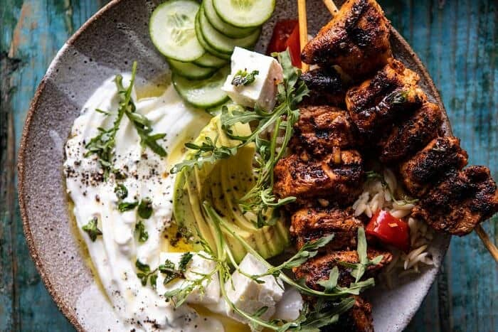 horizontal photo of Greek Lemon Chicken Bowls with Sizzled Mint Goddess Sauce