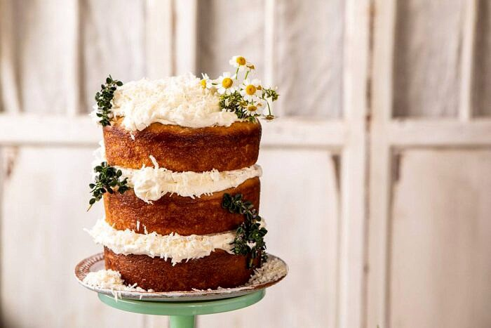 horizontal photo of Lemon Coconut Naked Cake with Whipped Vanilla Buttercream