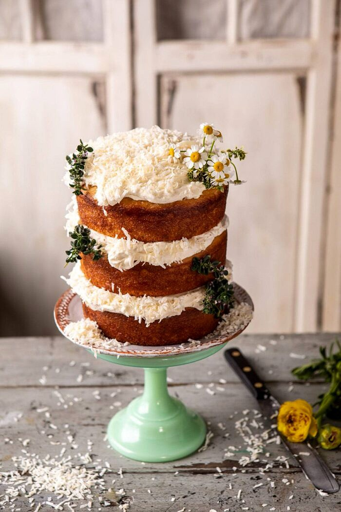 overhead photo of Lemon Coconut Naked Cake with Whipped Vanilla Buttercream on cake stand