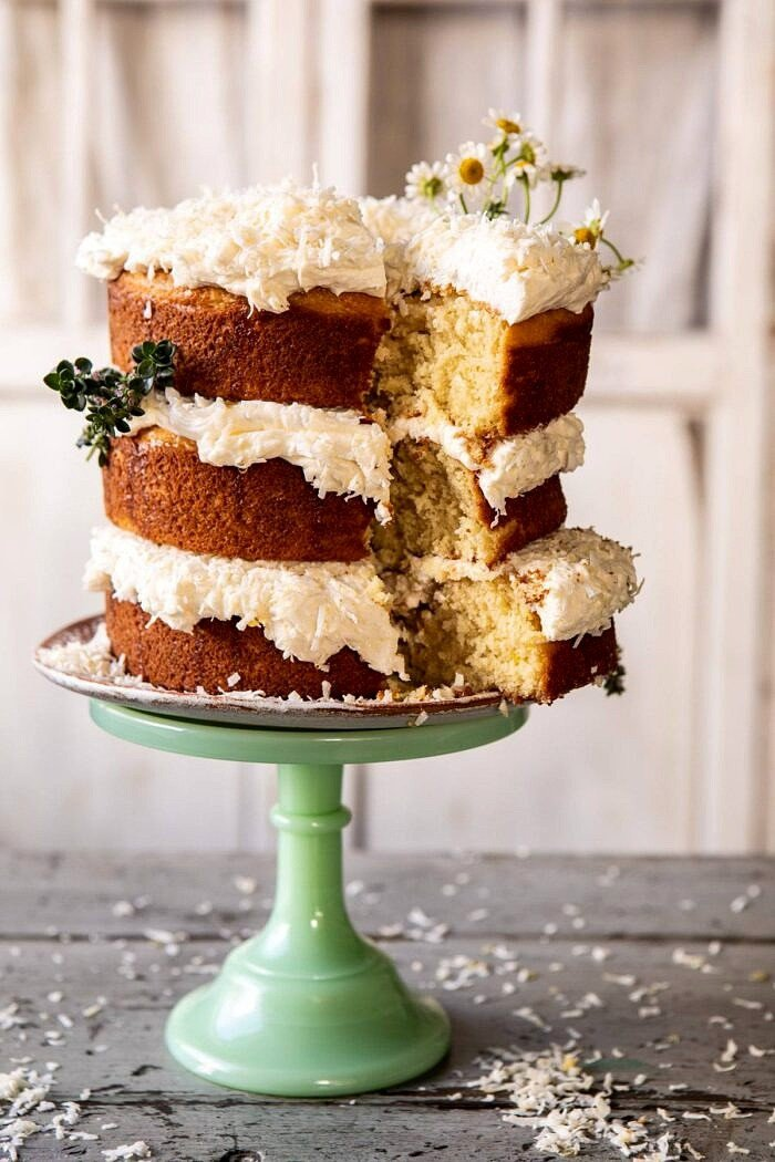 Lemon Coconut Naked Cake with Whipped Vanilla Buttercream with slice cut