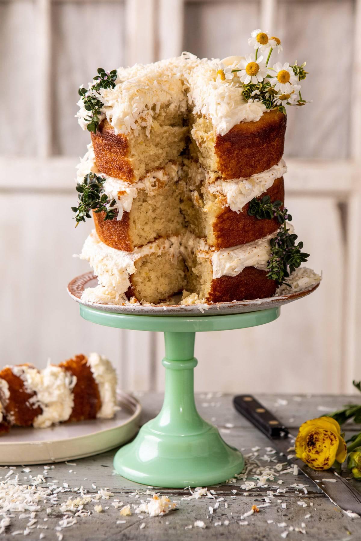 Lemon Coconut Naked Cake with Whipped Vanilla Buttercream | halfbakedharvest.com #coconutcake #springrecipes #easter #cake #layercake