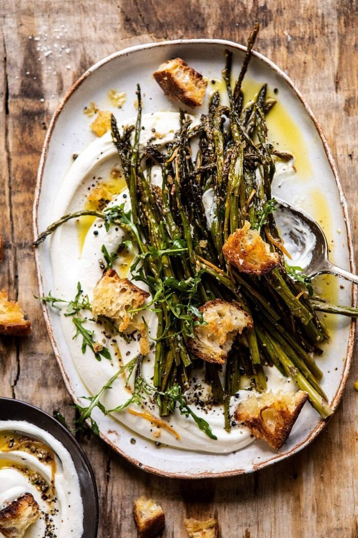 overhead photo of Sesame Roasted Asparagus with Whipped Feta and spoon on plate
