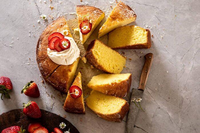 horizontal photo of Strawberry Chamomile Olive Oil Cake with Honeyed Ricotta