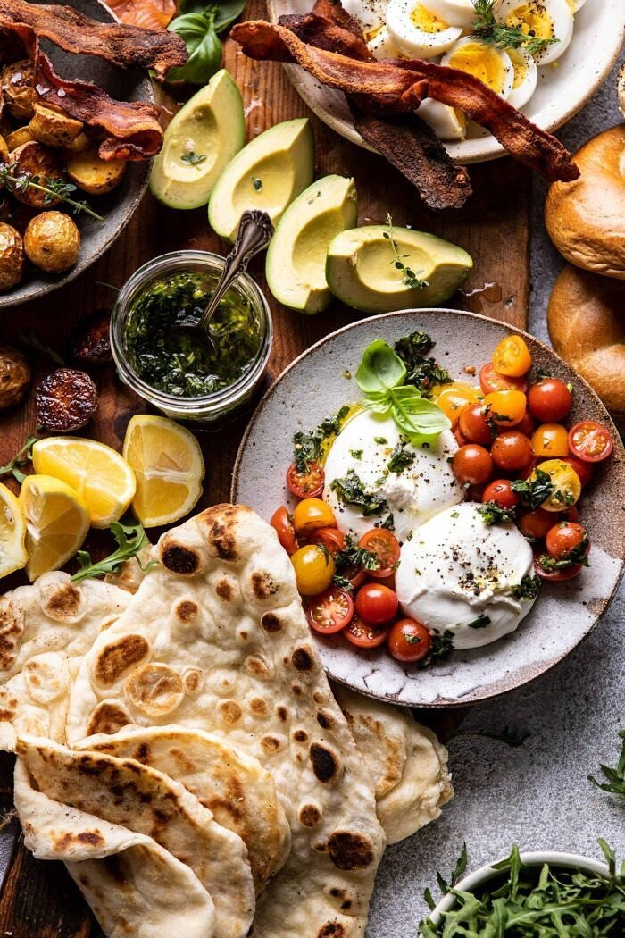 overhead photo of Ultimate Spring Brunch Board, close up photo of burrata and tomatoes