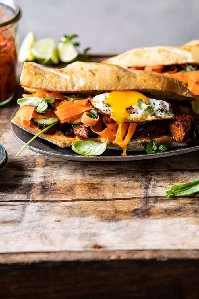 front on photo of 30 Minute Basil Chicken Banh Mi Sandwich with egg broken and yolk running