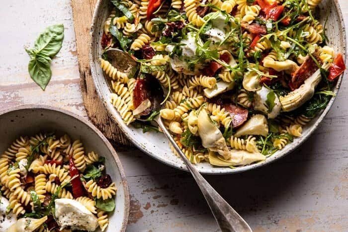 horizontal photo of Antipasto Pasta Salad with Herby Parmesan Vinaigrette