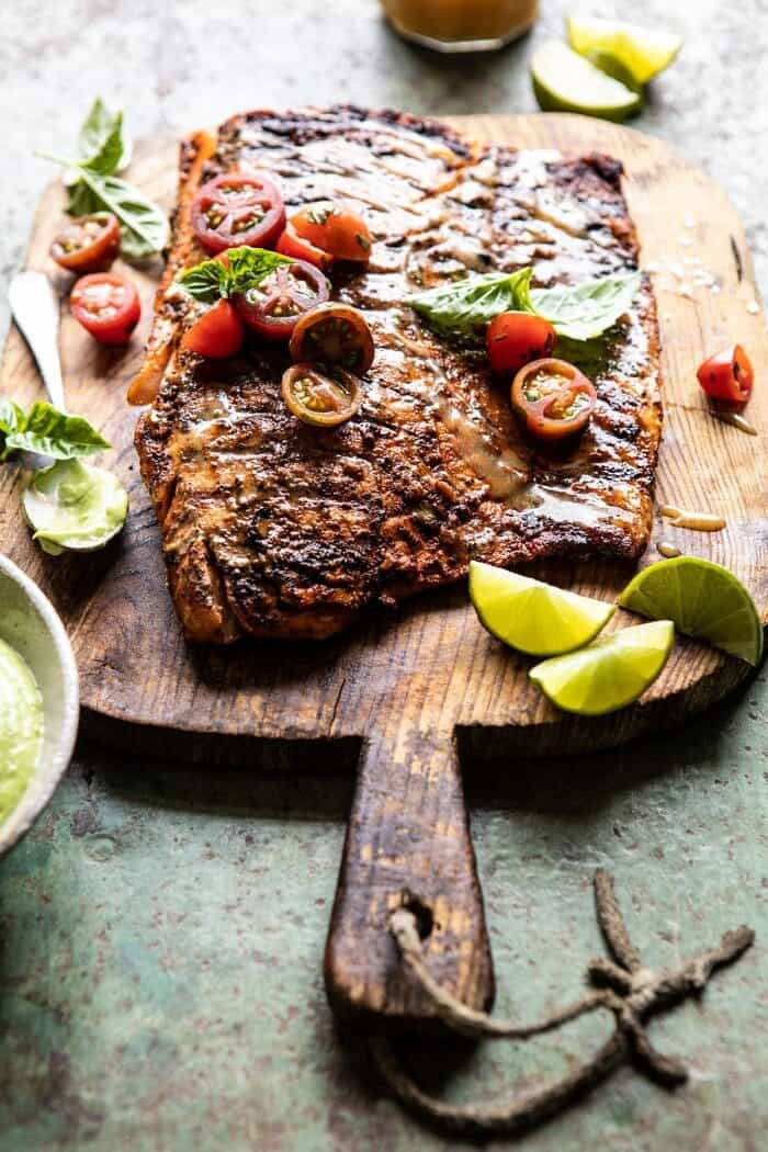 side angled photo of Honey Mustard Grilled Salmon with Avocado Basil Sauce