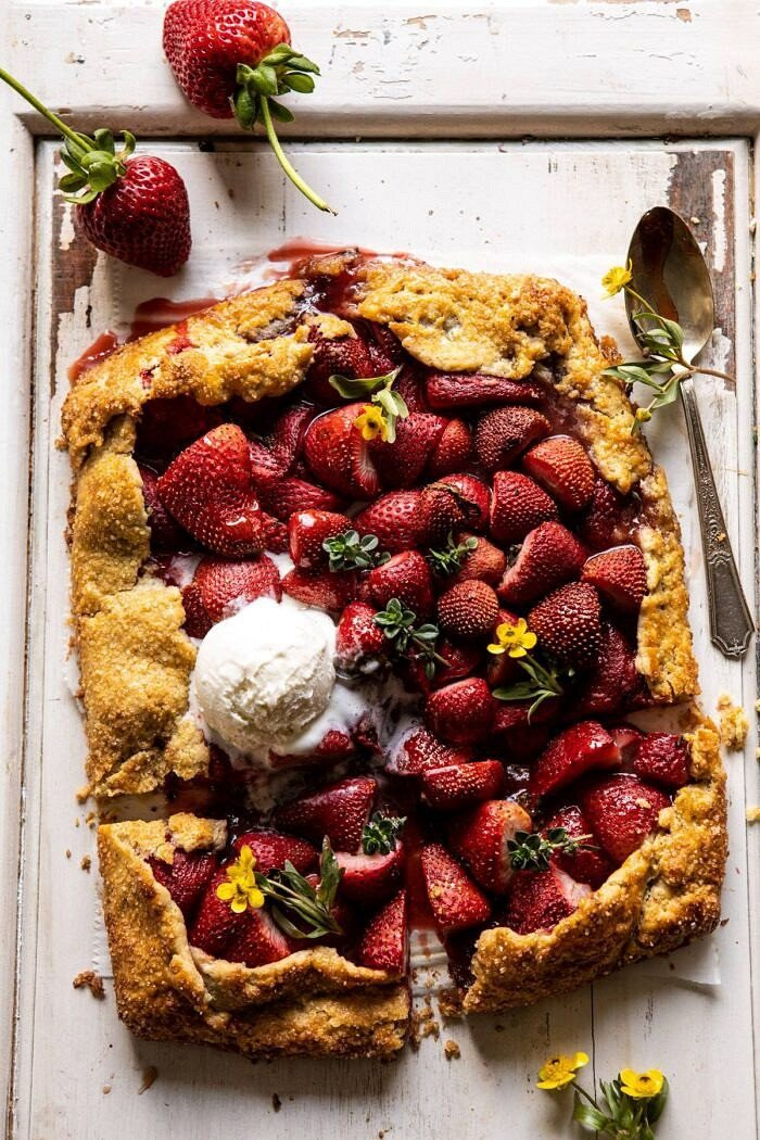 overhead photo of Jammy Strawberry Galette with ice cream and 2 pieces cut