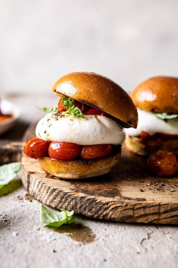 front on photo of Roasted Caprese Burrata Sliders on cutting board