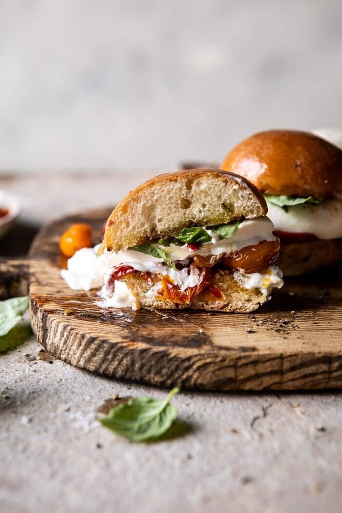 side angled photo of Roasted Caprese Burrata Sliders cut in half