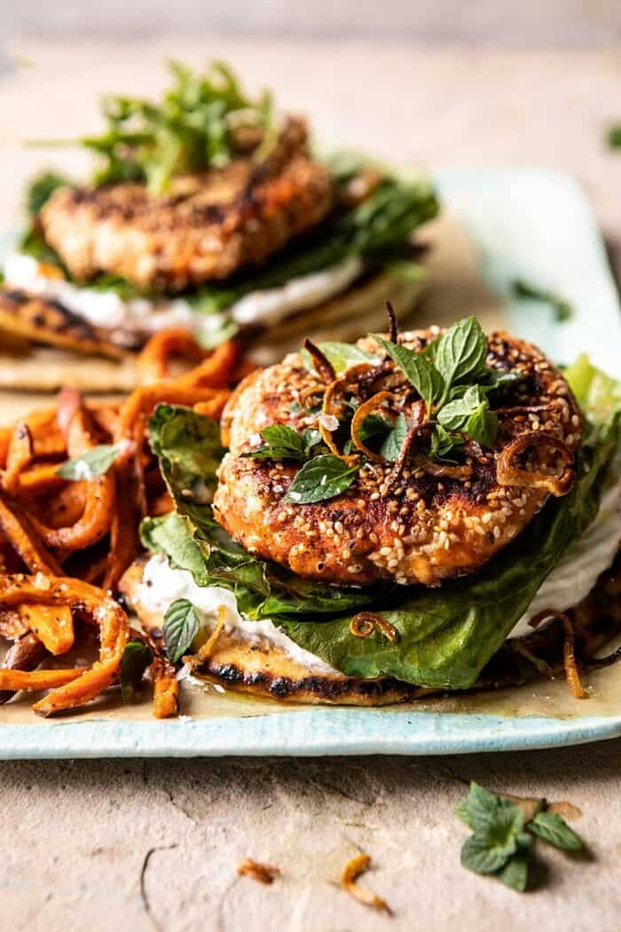 Sesame Crusted Curried Salmon Burgers with Lemony Herbs | halfbakedharvest.com #salmon #healthy #burger #summer