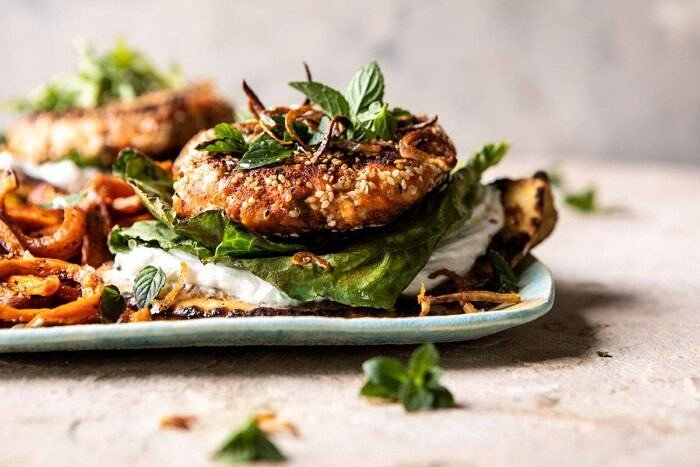 horizontal photo of Sesame Crusted Curried Salmon Burgers with Lemony Herbs