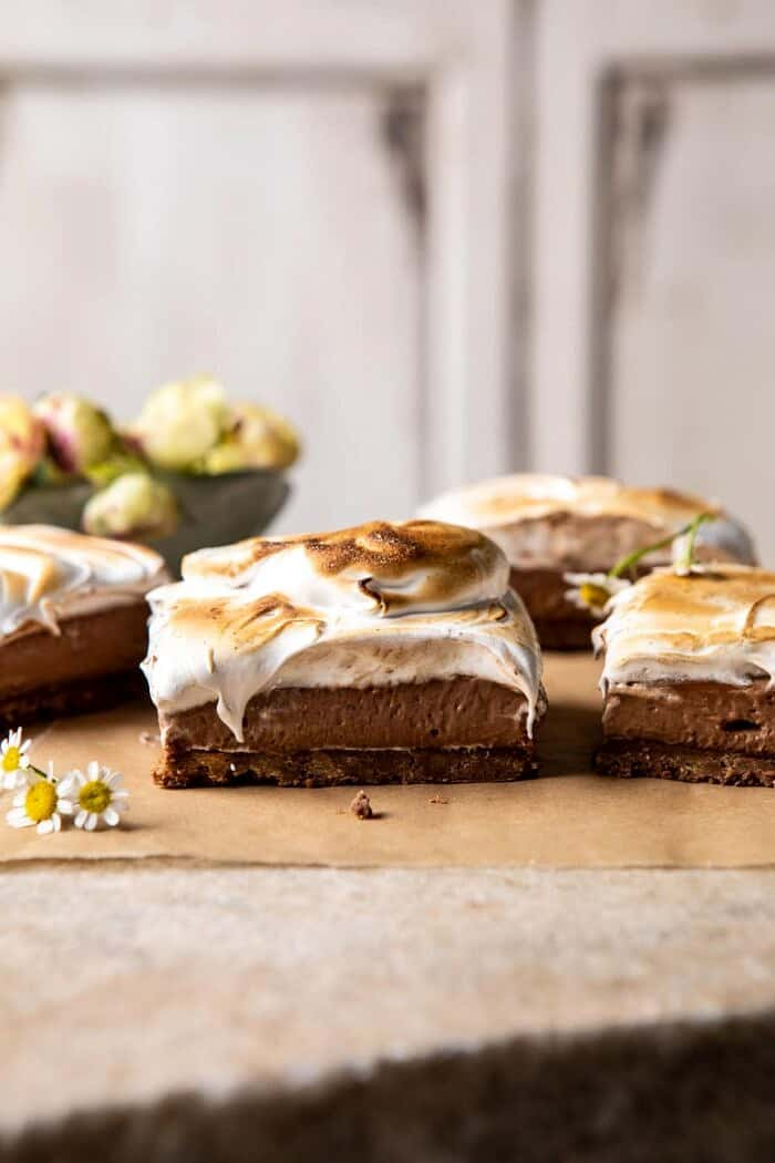 side angled photo of S'mores Chocolate Mousse Bars with flowers in the background