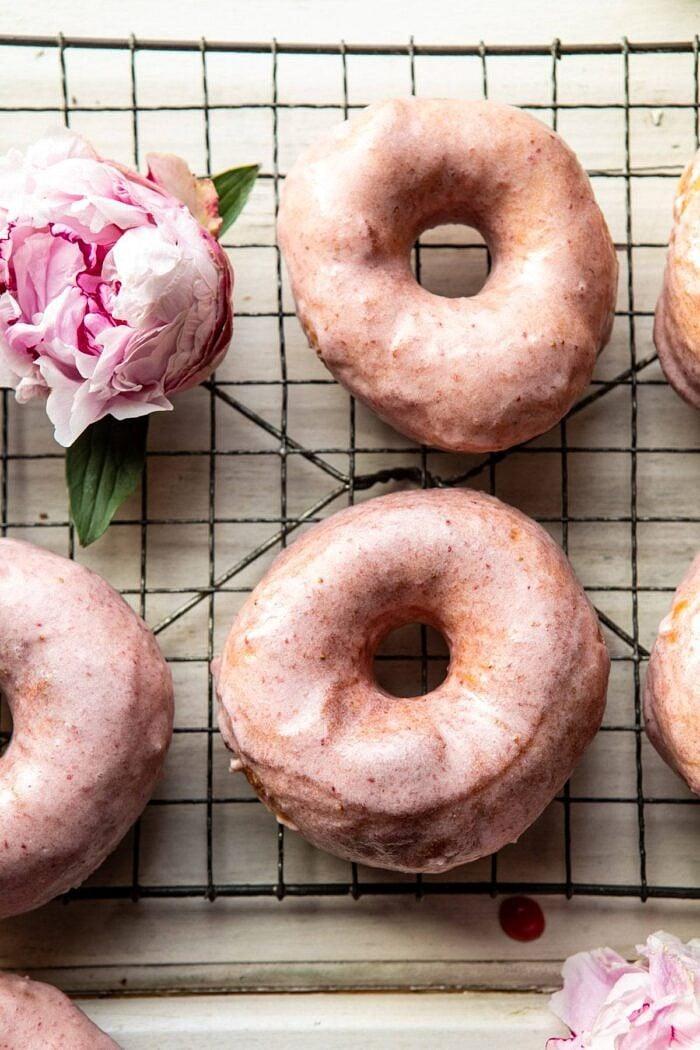 overhead close up photo of Strawberry Glazed Chai Doughnuts