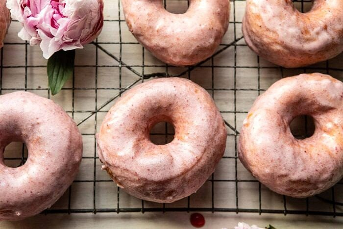 horizontal photo of Strawberry Glazed Chai Doughnuts