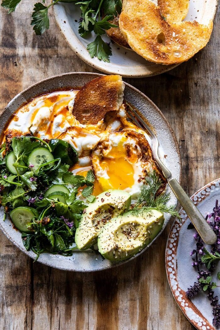 overhead photo of Turkish Eggs with eggs broken in bowl