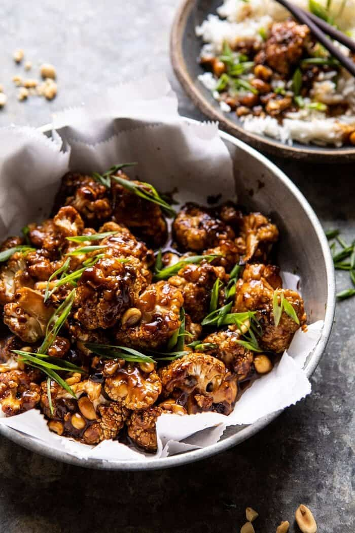 side angled close up photo of Better Than Takeout Kung Pao Cauliflower in serving bowl
