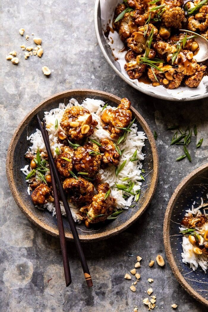 overhead photo of Better Than Takeout Kung Pao Cauliflower in a bowl with rice and chopsticks