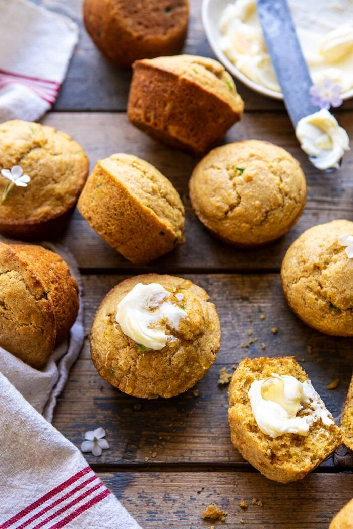 side angled photo of Browned Butter Jalapeño Cornbread Muffins with butter and honey on muffin