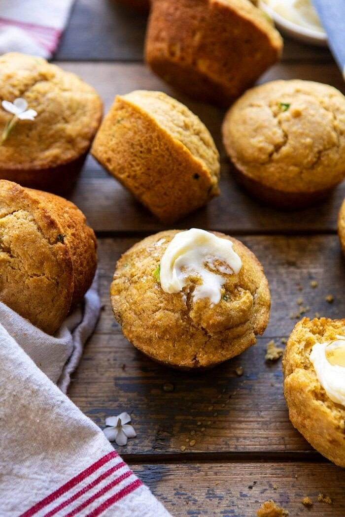 front on close up photo of Browned Butter Jalapeño Cornbread Muffins with butter
