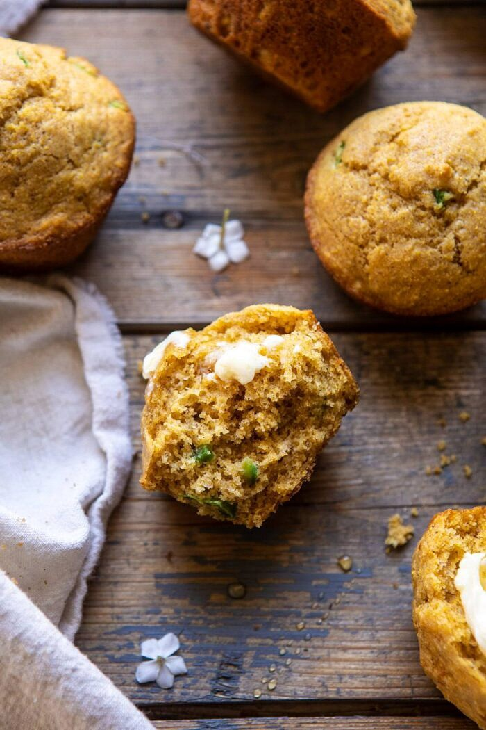 Browned Butter Jalapeño Cornbread Muffin broken in half with butter on muffin