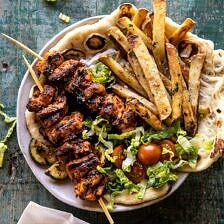 Chicken Souvlaki Bowls with Garlic Fries.