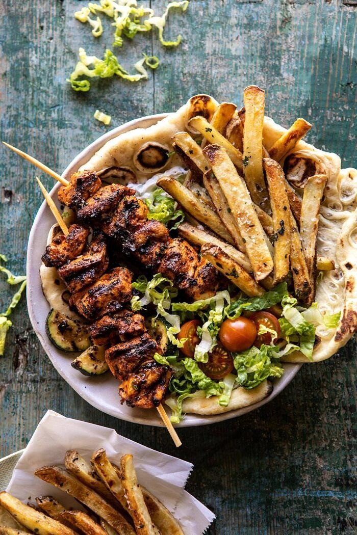 overhead photo of Chicken Souvlaki Bowls with Garlic Fries