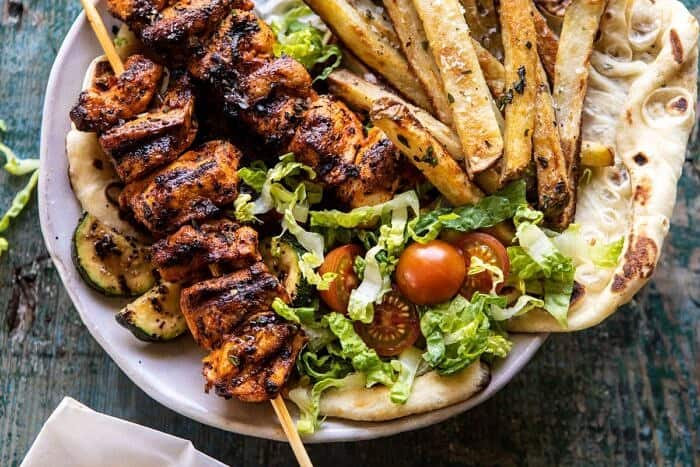 horizontal photo of Chicken Souvlaki Bowls with Garlic Fries