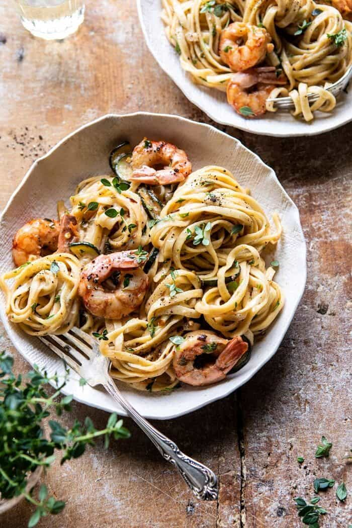 overhead close up photo of Garden Herb Shrimp Scampi Linguine with fork in bowl