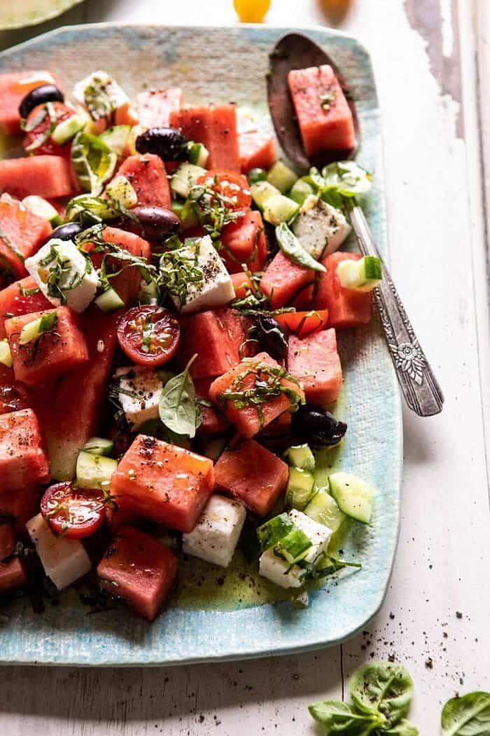 side angled photo of Greek Watermelon Feta Salad with Basil Vinaigrette