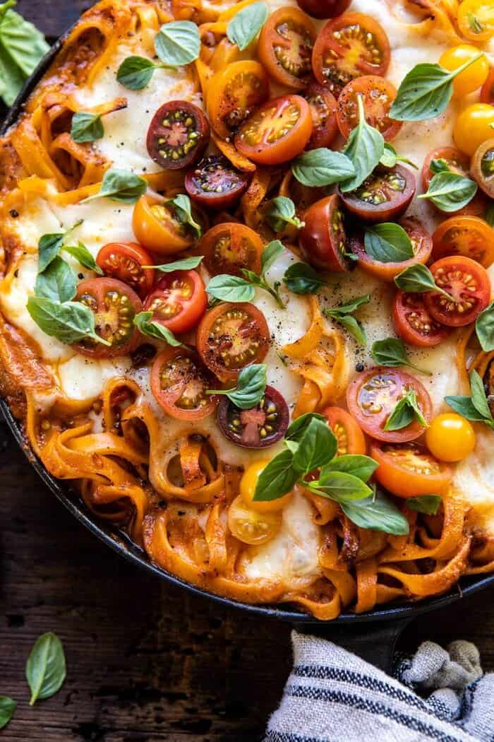overhead close up photo of One Pot 30 Minute Creamy Tomato Basil Pasta Bake in skillet