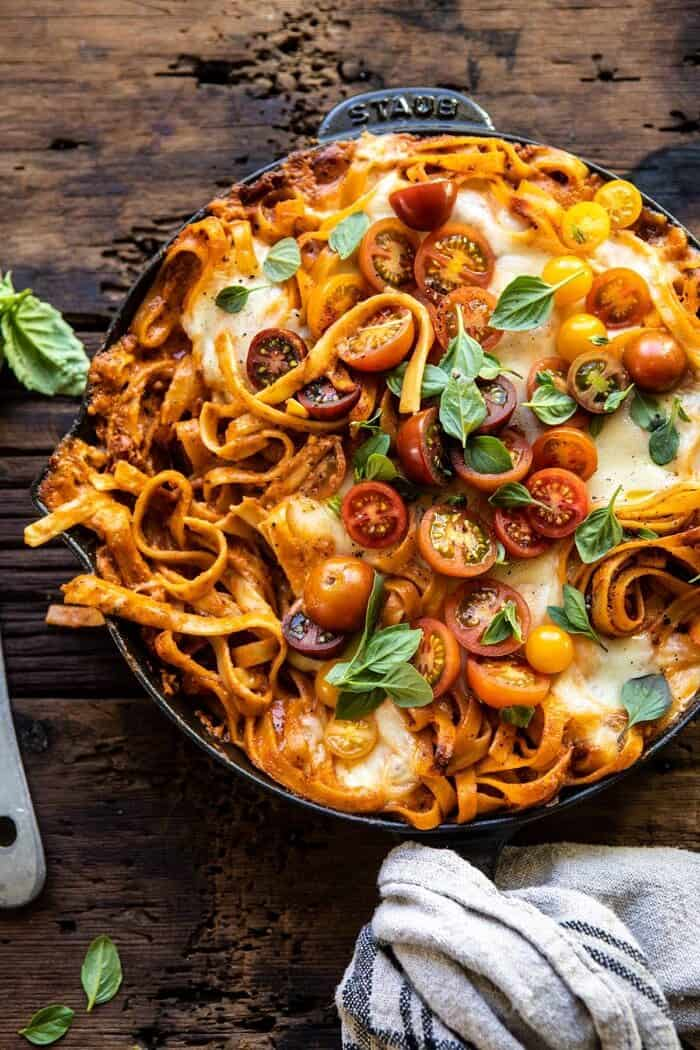 One Pot 30 Minute Creamy Tomato Basil Pasta Bake with serving of pasta removed from skillet
