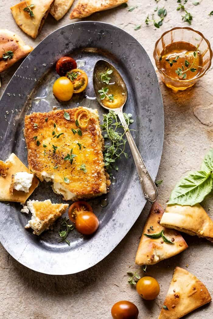 overhead photo of Pan-Fried Feta broken into pieces with Peppered Honey