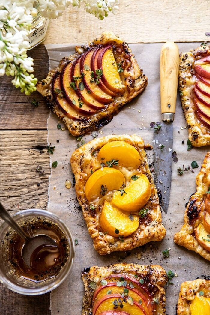 overhead close up photo of Peach Thyme Tarts with flowers in photo