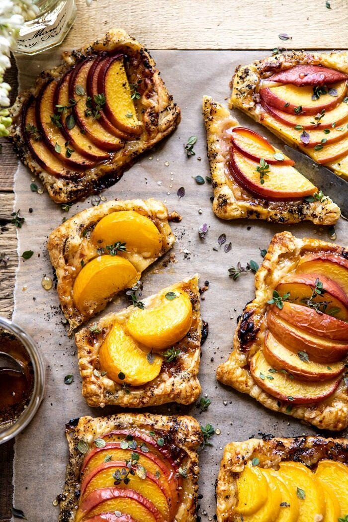 overhead close up photo of Peach Thyme Tarts with middle tart cut in half