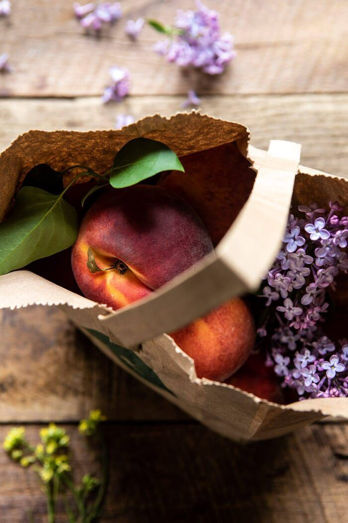 peaches in market bag with flowers