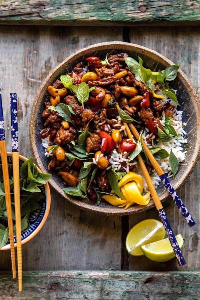 overhead photo of Better Than Takeout Sweet Thai Basil Chicken with chopsticks resting in bowl